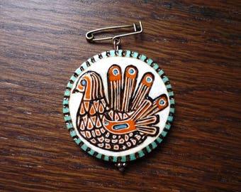 Brooch bird motif