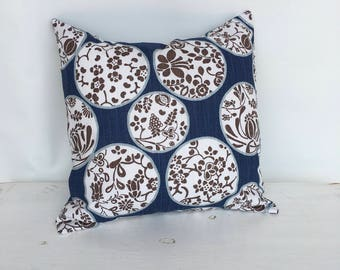 Blue floral print decorative pillow cover.