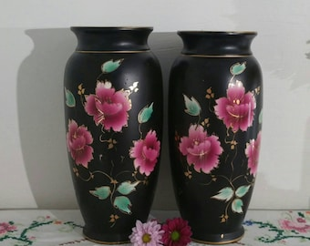 Vintage Antique black vase with  pink hand painted flowers made by Foch in England. Rare.