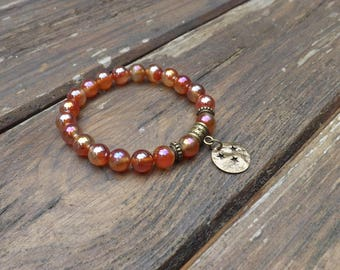 """Jai"" orange tone, glass and brass bracelet"