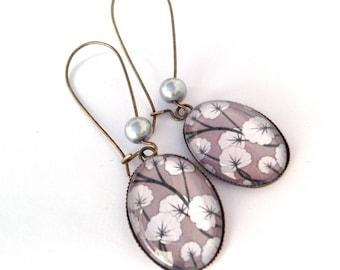 Hanging earrings oval cabochon white flowers on grey bottom bronze Japanese motive.