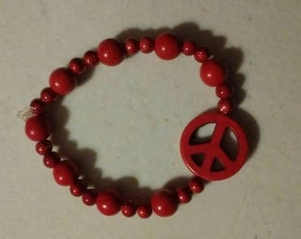 Red peace symbol stretch bracelet