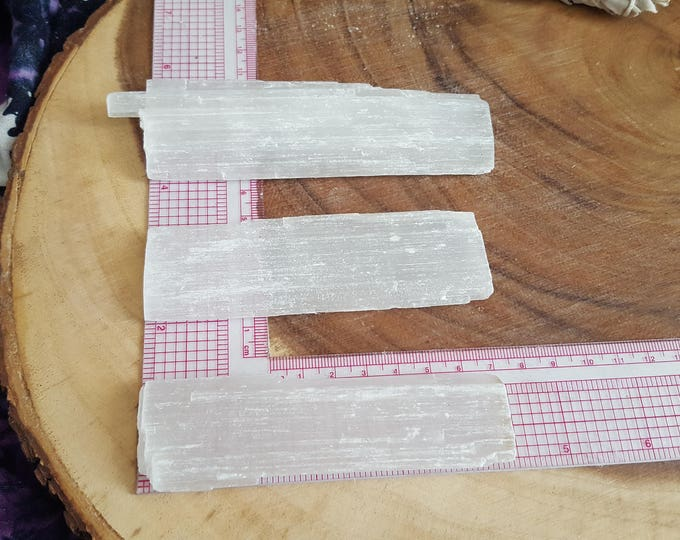 Selenite base for charging crystals, flat wand ~ 1 Reiki infused 4x1.5 inch (approximately) rough stick (wand)