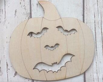 Cute laser cut wood pumpkin bat face heads in packs of three, five or ten