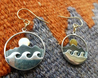 Island Dreams Earrings are evocative 3-D sunrises over island peaks and ocean waves. Wear these silver and gold beauties and dream...