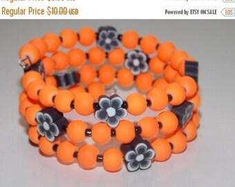 10%OFF Girls Neon Orange and Black Flower Bracelet