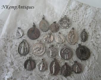 Religious pendant x 19