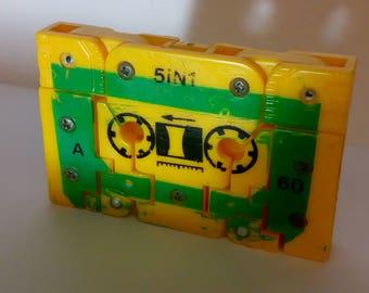 A vintage Transformer Cassette knock off figure of a yellow bird