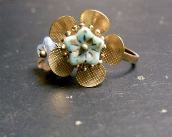 Pink flower in turquoise and old brass ring