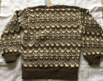 A Handknit lacy sweater made in the Traditional colours of the Jacob Sheep