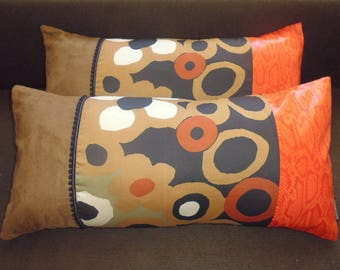 2 Brown and orange patchwork cushions