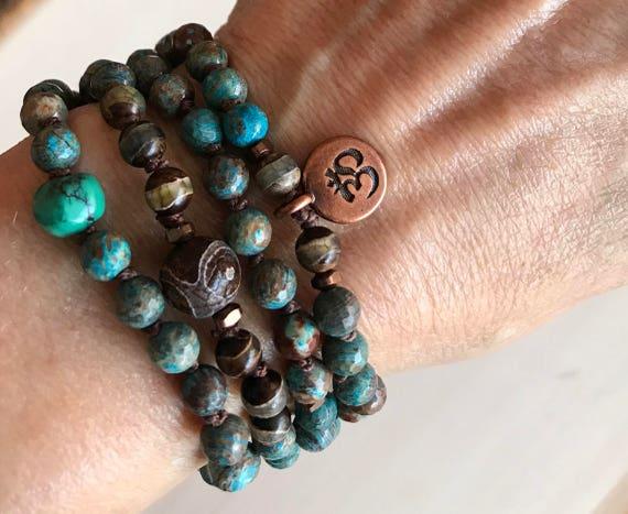 Throat Chakra Mala Beads, Rainbow Calsilica, DZI Beads, Lotus/Om Charm, Vishuddha Chakra, Unisex Knotted Wrist Mala Beads, Boho Mala Beads