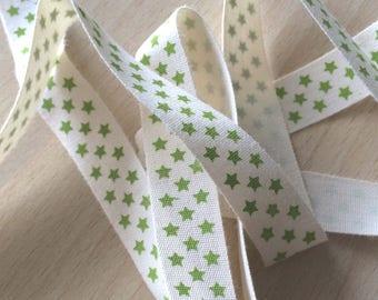 "decorative Ribbon: ""green stars"" on an ecru background"