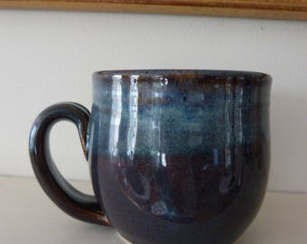 Stoneware mug in blues and browns.