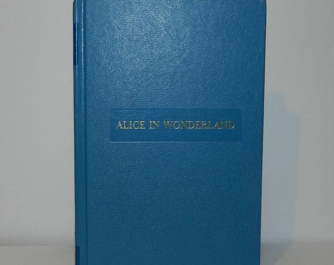 Best Loved Classics-Alice In Wonderland and Through The Looking Glass Author: Lewis Carroll