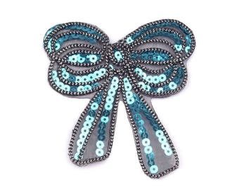 Bow of turquoise blue sequin iron on 9 x 11 cm