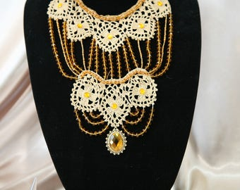 An elaborate beige crochet lace and topaz crystal beads necklace set for a special occasion