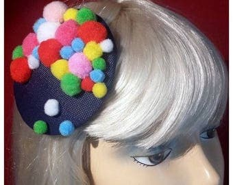 Colourful tiny hat with pom poms!