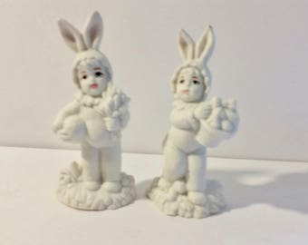 Set of 2 Vintage Easter bunny kids. Bisque porcelain figures hand painted accents. Similar to SnowBabies look.