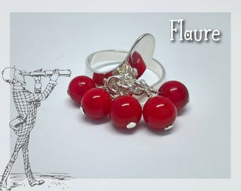 Silver ring and coral beads