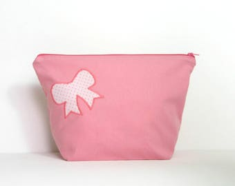 Kit toiletry bag, pink color and bow with pink polka dots