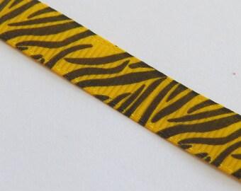 Pretty yellow ribbon with black tiger pattern