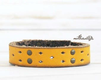CUSTOM HANDSTAMPED narrow yellow leather cuff with rivets by mothercuffer