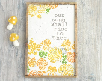 Wood Sign with Yellow and Orange Flowers. Hymn Lyrics. Our Song Shall Rise to Thee.