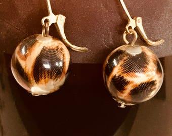 Globe leopard print drop earrings