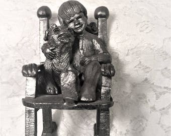 """Collectible Michael Ricker Cast Pewter Sculpture, """"Ray""""with Dog in Rocking Chair"""", 1984, Part of Children's Series, Limited Edition."""
