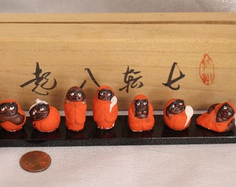 RARE Daruma set of Eight Mini Porcelain Figurines on a wood stand Made in Japan Bodhidharma