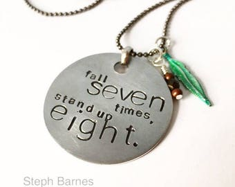 Fall seven times stand up eight ---necklace in  aluminum with black and verdigris green detail