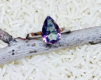 Teardrop shape Mystic topaz ring set in sterling silver (92.5). Size 7. Genuine natural mystic topaz .