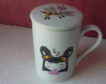 Mug à couvercle et passe thé
