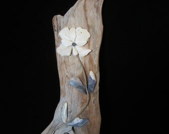 Driftwood Art- tumbled sea-shell flower. The weathered wood, twisted stem & blue leaves further complement the layered flower. Great Gift!