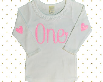 ONE Birthday Long Sleeve Shirt  White with neon pink glitter. Ruffled detail birthday shirt
