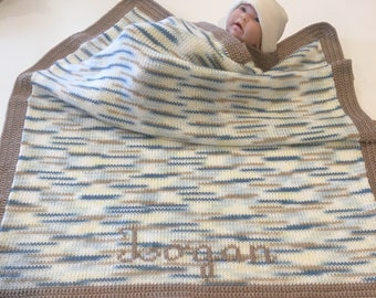 """Handmade knitted multicolored blanket with brown crocheted edging. Monogramming free. Size approximately 32""""X35""""."""