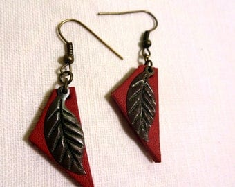 Earrings are made of genuine red leather and small metal leaf