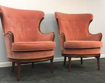 pair of vintage hand carved wingback chairs