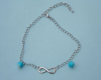 anklet with silver metal infinity sign