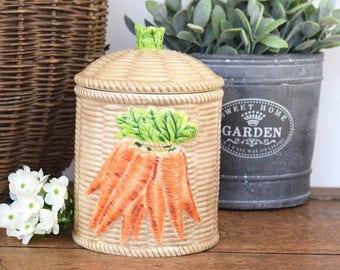 vintage ceramic storage jar or pot with lid and carrot motif.
