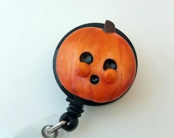 Spooky pumpkin Halloween badge reel