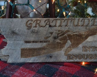 Gratitude...turns what we have...into enough. Laser engraved on wood. Young/old hand grasp.