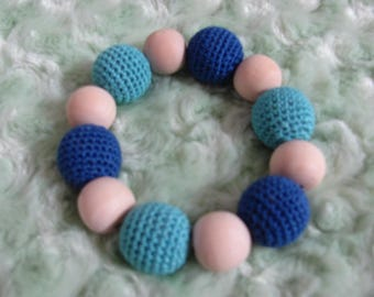 Shake your toy wooden beads and crochet for baby