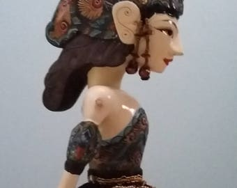 Vintage wooden Indonesian wayang puppet, shadow puppet, theatre, drama