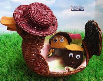 Couple of felt, caramel and chocolate Easter eggs