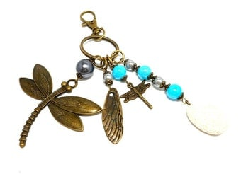 A scent! bronze bag charm, dragonfly turquoise and gray beads