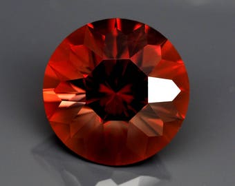 3.83 ct Red Oregon Sunstone. Custom Cut. Natural, untreated loose gemstone. Precision faceting. Fancy round.