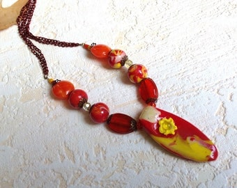 Necklace, yellow, red, orange, polymer clay, oval shaped pendant.