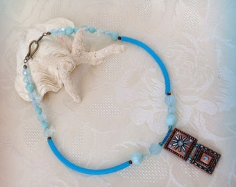 Necklace, turquoise, copper pendant, seed beads, faceted translucent beads.